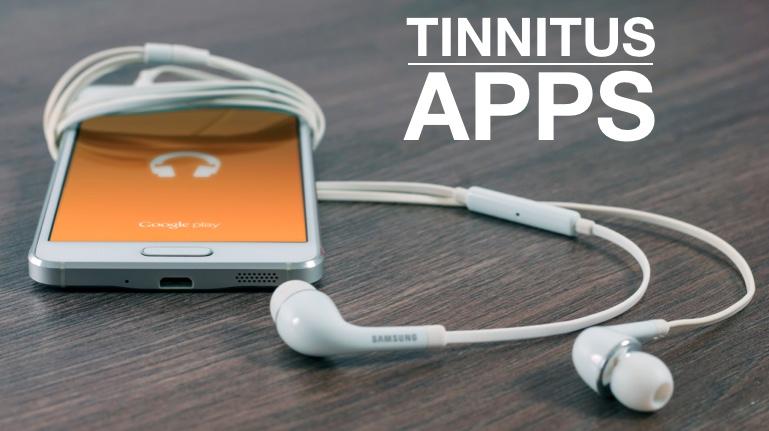 Das Bild zeigt ein Mobiltelefon mit Kopfhörern. Text: Tinnitus Apps