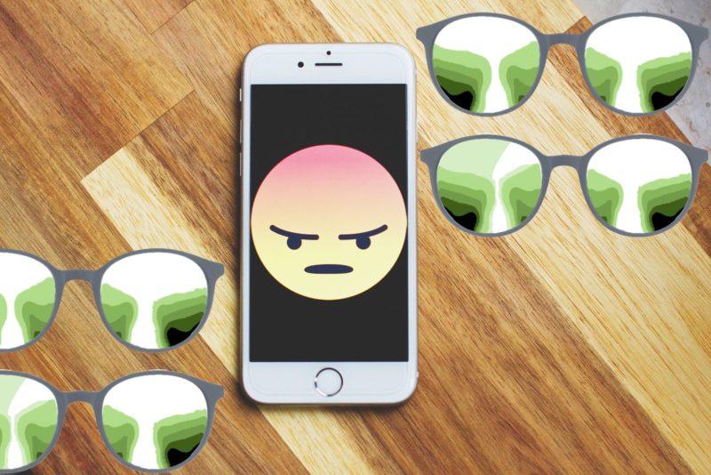 Das Bild Zeigt einen verärgerten Smiley auf einem Smartphone unddaneben unschärfenbereiche einer Gleitsichtbrlle