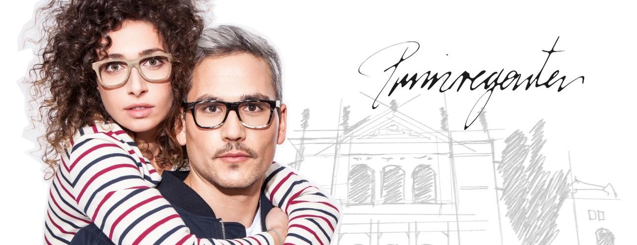 Das Bild zeigt eine Frau und einen Mann mit den aktuellen Wood Fellas Brillen