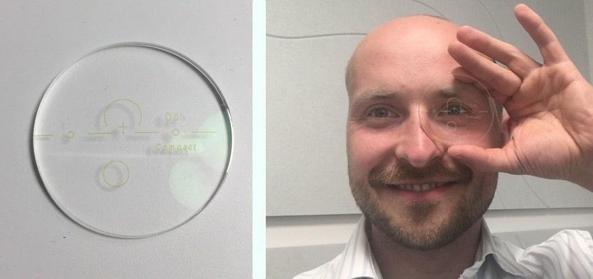 Das Bild zeigt ein Gleitsichtglas mit Slab Off vor weißem Hintergrund und vor einem Gesicht