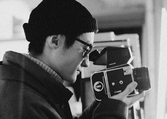 Fotograf mit Brille